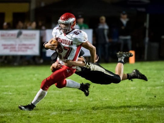 Bermudian Springs' Ryan Curfman (27) runs the ball against Delone Catholic on Friday, Oct. 13, 2017. The Eagles won in overtime 10-7.