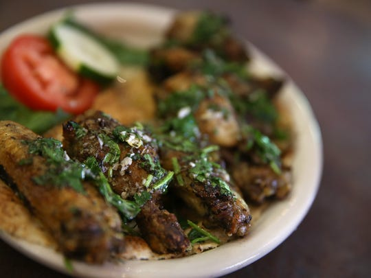 Djej, a dish of grilled chicken wings marinated with a hint of Mediterranean spice, is served up at Sinbad's Mediterranean Cuisine in the Park Avenue neighborhood of Rochester. The long marinade and spice preparation of the wings make them like no other wings in Rochester.