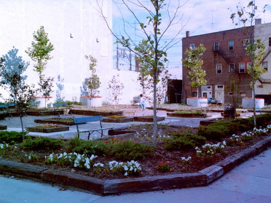 Constructed in 1973 by Project GREEN at the corner of Washington and Dubuque streets, volunteers created an oasis in the midst of Iowa City's Downtown Urban Renewal Project. Photo taken in 1974 before the famous Black Hawk Mural was painted on the building wall.