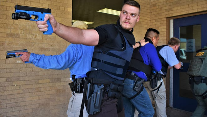 Law enforcement officers from several San Angelo agencies conduct an active shooter training on July 20, 2018 at Robert E. Lee Middle School.
