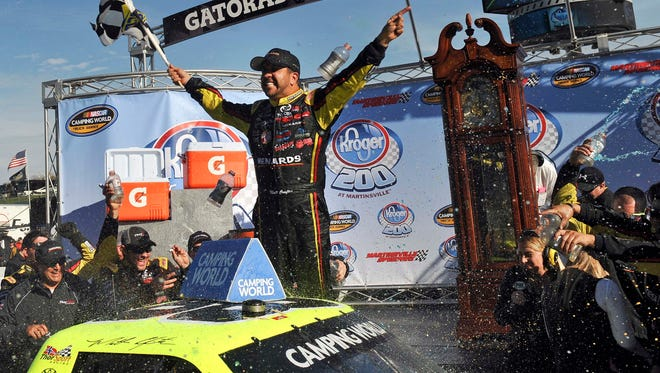 NASCAR Camping World Truck Series driver Matt Crafton celebrates his victory of the Kroger 200 at Martinsville Speedway.