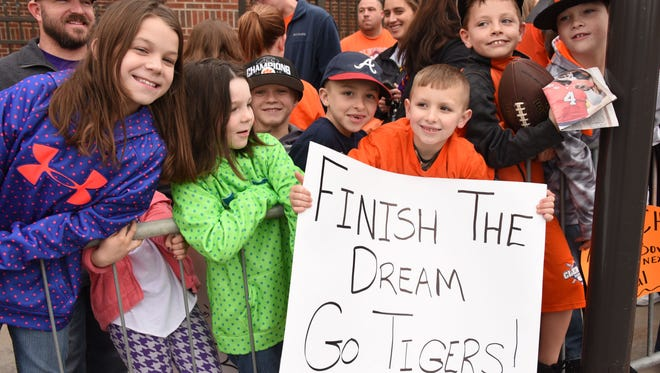 A crowd of about 2,000 fans welcomed the Clemson football team as it returned back to campus following its Orange Bowl victory over Alabama.
