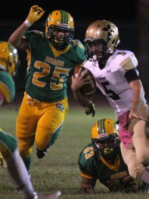 Xavier Prep's Michael Johnson (5) fights for a few yards during a game against Coachella Valley on Friday.