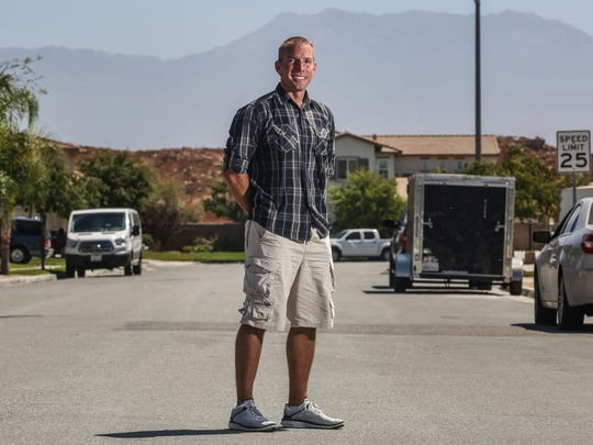Highway Patrol Officer Dane Norem, who was stabbed seven times while stopping a suicide in 2012, is photographed outside his home in Hemet on August 15, 2017.
