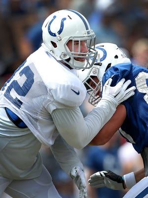 Indianapolis Colts outside linebacker Bjoern Werner (92),left, slaps tight end Coby Fleener (80) out of the way during drills at the Colts training camp Monday, August 10, 2015, afternoon at Anderson University in Anderson IN.
