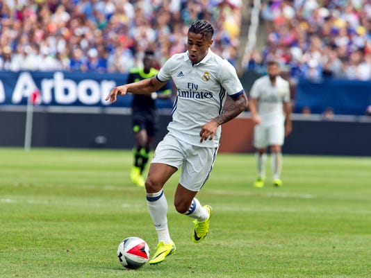 FILE- In this July 30, 2016 file photo, Real Madrid forward Mariano Diaz Mejia dribbles the ball in the first half of an International Champions Cup soccer match against Chelsea in Ann Arbor, Mich. Striker Mariano Diaz has joined Lyon from Real Madrid to fill the void left by Alexandre Lacazette's departure to Arsenal. (AP Photo/Tony Ding, File)