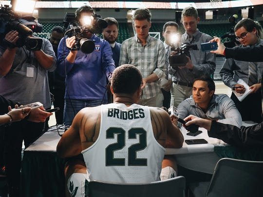 Michigan State's Miles Bridges talks with reporters