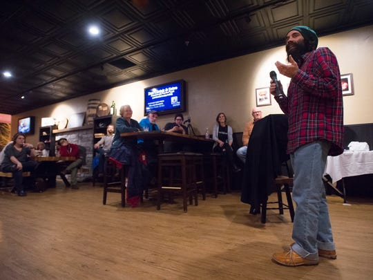 Rico Lighthouse speaks during the Coloradan Storytelling event at William Oliver's Publick House Thursday, December 10, 2015.