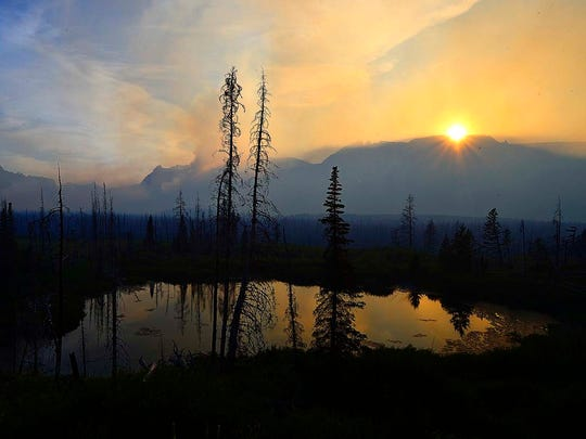 The sun sets over St. Mary and the Reynolds Creek Fire on Wednesday evening in Glacier National Park.