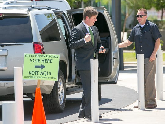 Phoenix Mayor Greg Stanton drops off his ballot at
