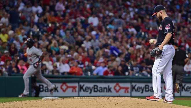 Cleveland Indians starting pitcher Corey Kluber, right, waits for Detroit Tigers' Justin Upton to run the bases after a solo home run in the second inning.