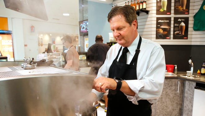 Joe Hufford, President/CEO of J.L. Hufford Coffee & Tea Company, at work Friday, August 12, 2016, at the popular coffee shop in the Tippecanoe Mall. J.L. Hufford Coffee & Tea is celebrating its 25th anniversary.