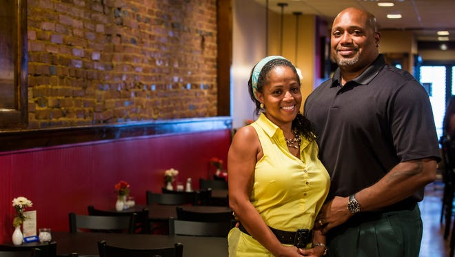 Steve and Khim Taylor pose for a portrait in their restaurant, Twisted Soul, on Market Street in Wilmington on Wednesday afternoon. The Taylors are two of the restaurant's five owners.