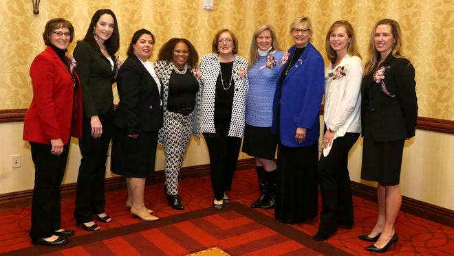 These nine women (L to R) Rita Shacklett, Christy Hackinson, Dawn Rhodes, Veronica Terrell, Barbara Sutton, Anna-Gene O'Neal, Diane Turnham, Dana Dement Jones and Retta Gardner were recognized during the 2017 Women in Business on Tuesday, March 14, 2017, that was presented by Murfreesboro Magazine, and held at Embassy Suites. Krista Dugosh was not photographed but was also recognized.