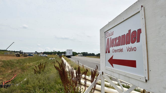 Pictured on June 22, Blaise Alexander, a car dealership is under construction at Antrim Commons Business Park.