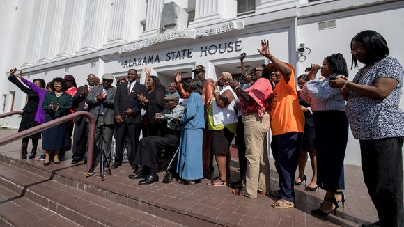 Montgomery City Councilman David Burkette, surrounded by supporters, announces his race for the state Senate seat recently vacated by former Sen. Quinton Ross, on the steps of the Alabama Statehouse in Montgomery, Ala. on Tuesday October 10, 2017.