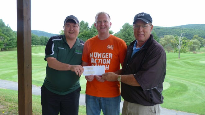 The Links and Lanes Tournament held recently raised more than $1,200 and 137 pounds of non-perishable food for Food Bank of the Southern Tier. From left are Bobby Downing, director of bowling services at Crystal Lanes in Corning, Jonathan Fuller, the food bank's public relations manager, and Bob Adams, owner of Willowcreek Golf Club in Big Flats.