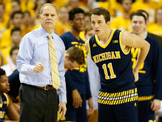 Michigan coach John Beilein talks with Andrew Dakich