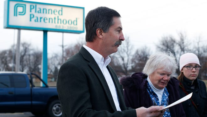State Rep. Mike Moon and other anti-abortion activists hold a press conference outside Planned Parenthood on Monday, Dec. 12, 2016.