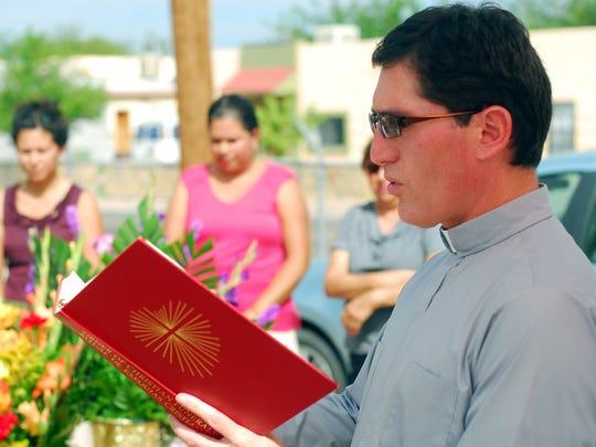 Father Ricardo Bauza, pastor of St. Genevieve's Catholic