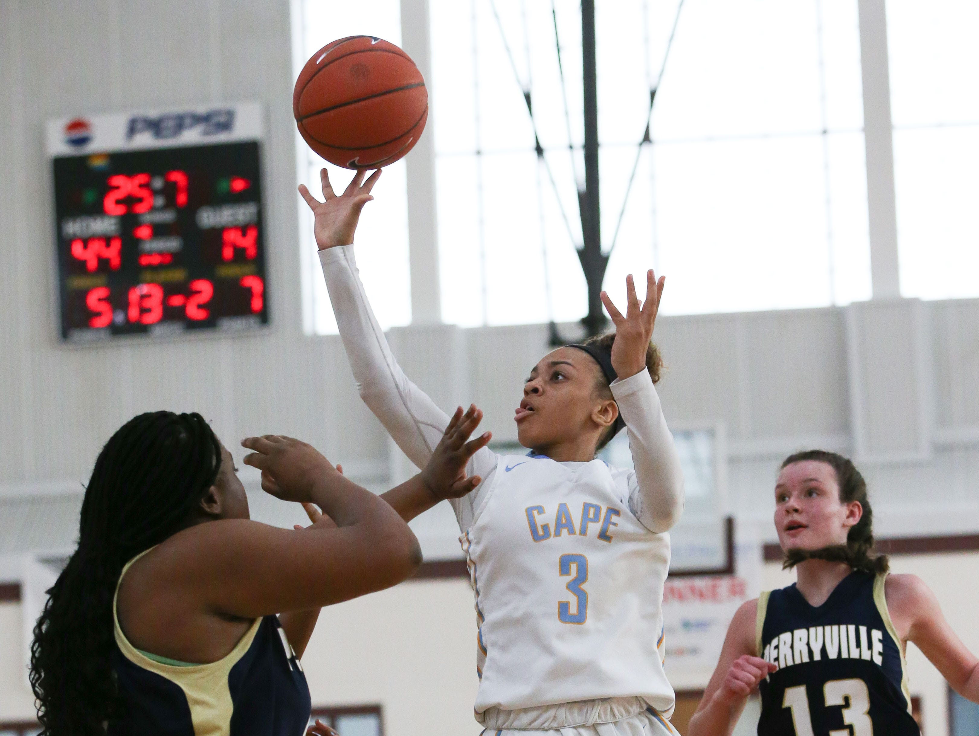 Cape Henlopen guard Dania Cannon puts up a shot in the third quarter while surrounded by Perryville defenders in the opening round of the New Castle Insurance Cup at the Diamond State Classic Tuesday.