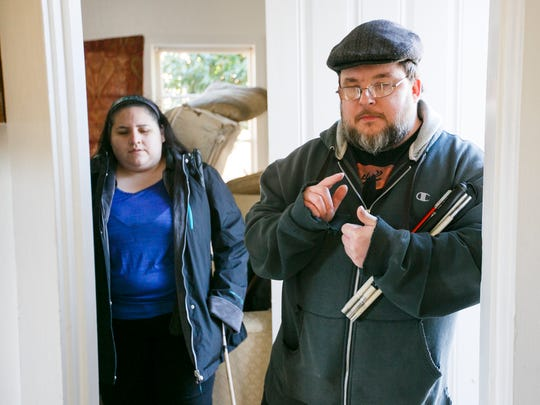 Jason Lindial, who is partially blind, and his partner Jetzabel Franco, who is legally blind, list off some of the items stolen from their home last week on Tuesday, Jan. 24, 2017. The pair are getting some help from the Marion County District Attorney's Victim Assistance Division, including a new laptop for Lindial's work, but it does not have the screen-reading software he needs to complete his work as a transcriptionist.