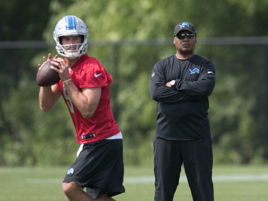 Lions coach Jim Caldwell watches quarterback Matthew Stafford go through drills during OTAs on May 24, 2017 at the Allen Park practice facility.