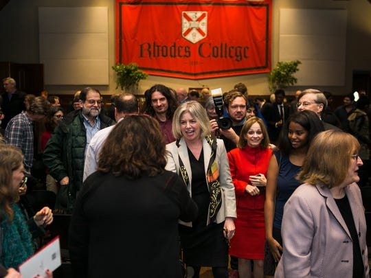 Dr. Marjorie Hass, center, greets people in December 2016 following a press conference after it was announced that she'd been named the new president of Rhodes College, the school's 20th president. (Yalonda James/The Commercial Appeal)