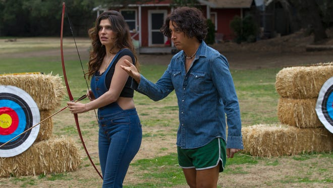 David Wain, in a 'Wet Hot American Summer: First Day of Camp' scene with Lake Bell, is getting the gang back together for another Netflix series.
