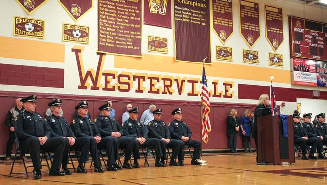 Westerville community members gather at Westerville North high school to share their stories of officers Eric Joering and Anthony Morelli after they were both shot on Saturday. The community shared their support for the police and their families.