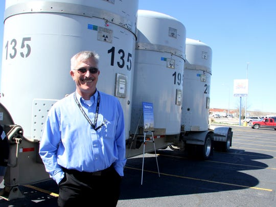 Carlsbad Field Office Institutional Affairs Manager James Mason stands in front of a trailer carrying three TRUPACT-II shipping containers during a WIPP road show on Wednesday.