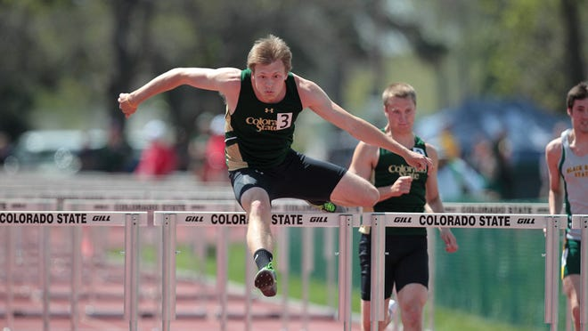 CSU's Josh Cogdill, shown running the hurdles at a home meet, won the Mountain West title Thursday in the decathlon at the conference's championship meet in San Diego.