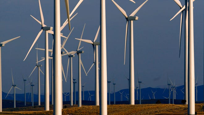 This file photo shows a wind turbine farm near Glenrock, Wyoming. Most of the wind farms built in the U.S. over the past several years have gone up in the western states.