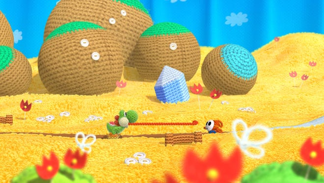 """""""Yoshi's Woolly World"""" features an impressive visual look that re-imagines Nintendo's lovable dinosaur and his escapades in yarn form."""