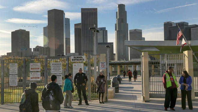 Los Angeles-area students head back to school at the Edward R. Roybal Learning Center in Los Angeles, a day after an emailed threat triggered a shutdown of the vast Los Angeles Unified School District.