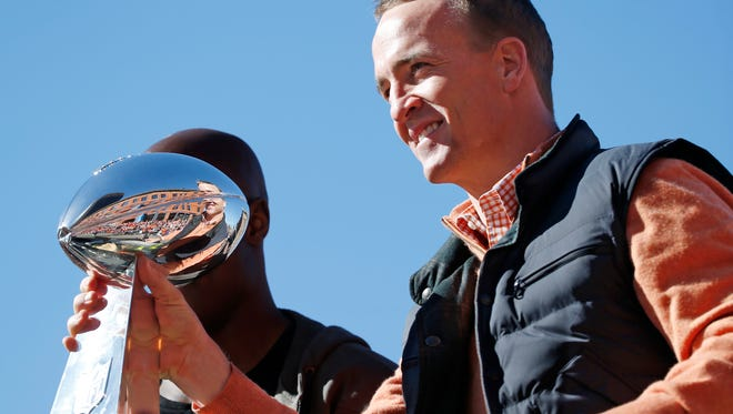 Denver Broncos quarterback Peyton Manning, shown holding the Lombardi Trophy during a victory parade in Denver, will be the headline speaker June 3 at the S.D. Sports Awards.