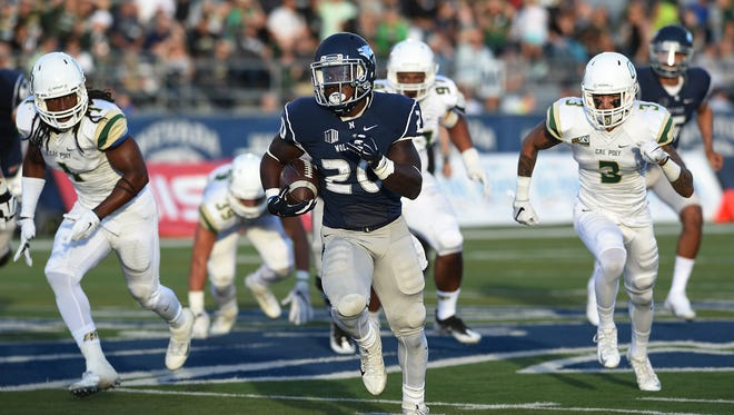 Nevada's James Butler runs for a first-quarter touchdown against Cal Poly last Friday. Butler and the Wolf Pack player at Notre Dame on Saturday.