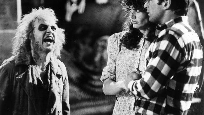 """Beetlejuice"" will be shown at 8 p.m. Oct. 21 at Ascarate Park as part of the free Movies by the Lake film series. Geena Davis and Alec Baldwin, right, react in horror when they first encounter the demonic Betelgeuse, portrayed by Michael Keaton, in the 1988 supernatural comedy ""Beetlejuice."""