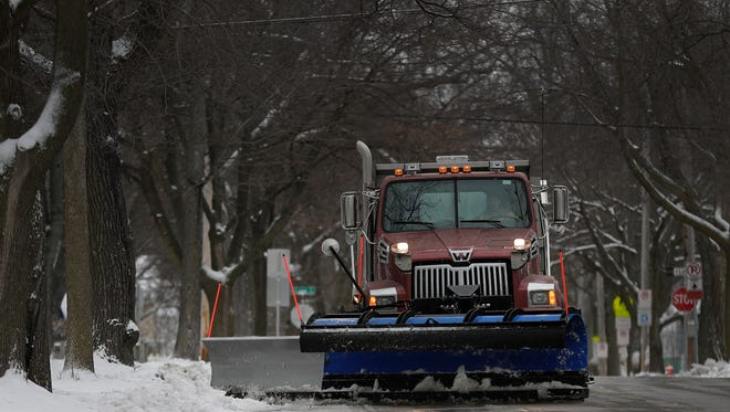 Images of snow removal should be a thing of the past real soon as spring-like weather finally arrives across Wisconsin. Wm. Glasheen/USA TODAY NETWORK-Wisconsin