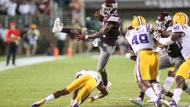Mississippi State's Aeris Williams (22) jumps over an LSU defender. Mississippi State and LSU played in an SEC college football game on Saturday, September 16, 2017 at Davis Wade Stadium in Starkville. Photo by Keith Warren (Mandatory Credit)
