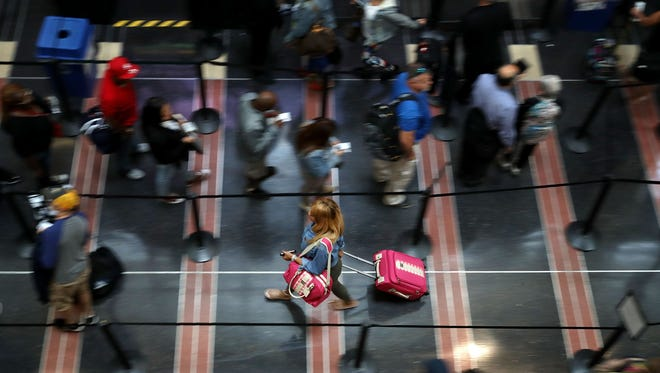 Travelers move through a  Transportation Security Administration line at Ronald Reagan National Airport on Sept. 1, 2017