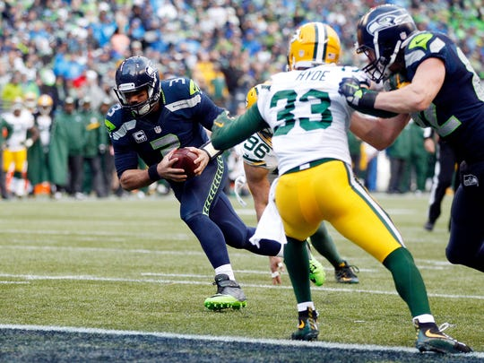 Seattle Seahawks quarterback Russell Wilson runs for a touchdown during the fourth quarter of Sunday's NFC championship game at CenturyLink Field in Seattle.