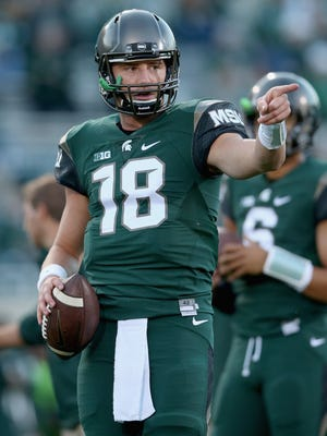 Connor Cook of the Michigan State Spartans warms up for a game against the Oregon Ducks on Sept. 12, 2015, in East Lansing.