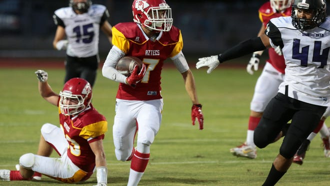 Palm Desert's Tristen Sinkinson carries the ball against Shadow Hills in the first quarter on Thursday at Palm Desert High.