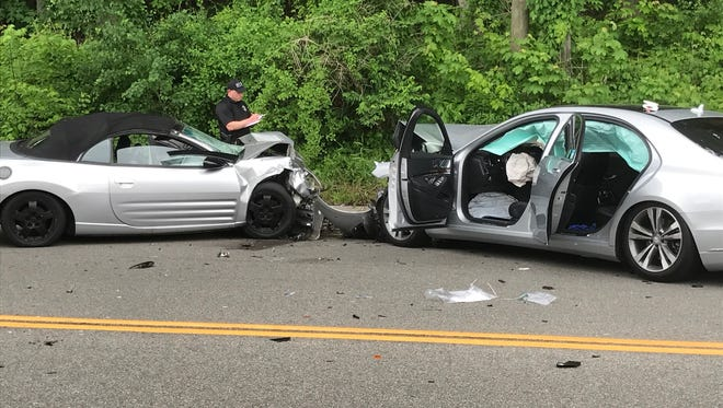 Police at the scene of a fatal head-on collision on Route 22 in Southeast, Tuesday, May 23, 2017. The driver of one car died and the driver and a passenger in the other car were injured. The investigation closed Route 22.
