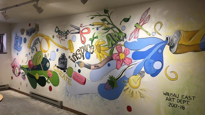 A mural created by Wausau East High School art students is meant to inspire senior residents at Homme Homes' Forest Park Village.