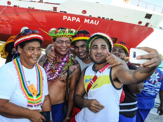 "Tony Piailug, second from left, son of the late traditional navigator Pius ""Mau"" Piailug, poses for a selfie with others during a vessel naming ceremony at the Port Authority of Guam on Sept. 16, 2016. The shipping company Matson named one of its vessels, ""Papa Mau,"" after the man who is sometimes referred as the ""Micronesia's grand master navigator""."