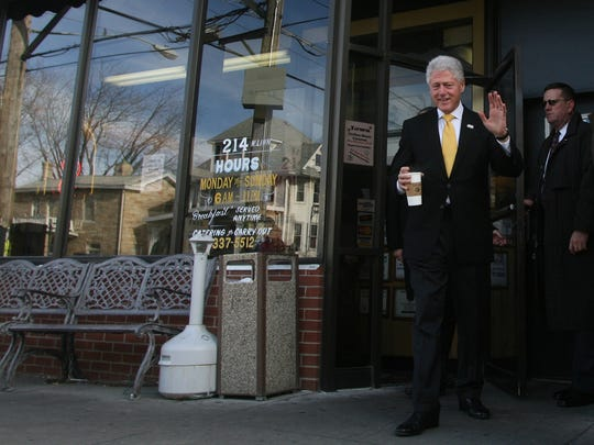 Former President Bill Clinton waves as he leaves the