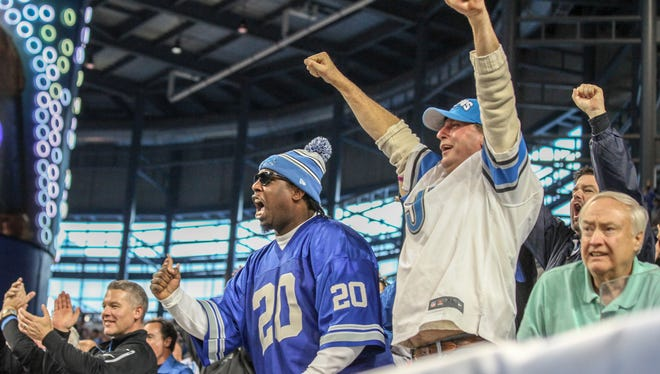 Detroit Lions fans cheer after holds the Oakland Raiders in the fourth quarter, during the NFL game at Ford Field in Detroit on Sunday, Nov. 22, 2015.