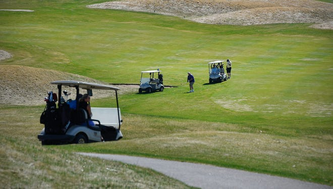 Gov. Tim Walz on Friday announced golf courses and driving ranges could open Saturday. He urged appropriate social distancing be used for all outdoor activities.